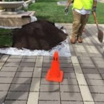 Lift pavers and perform stucco deconstructive testing at podium to wall and soffits.