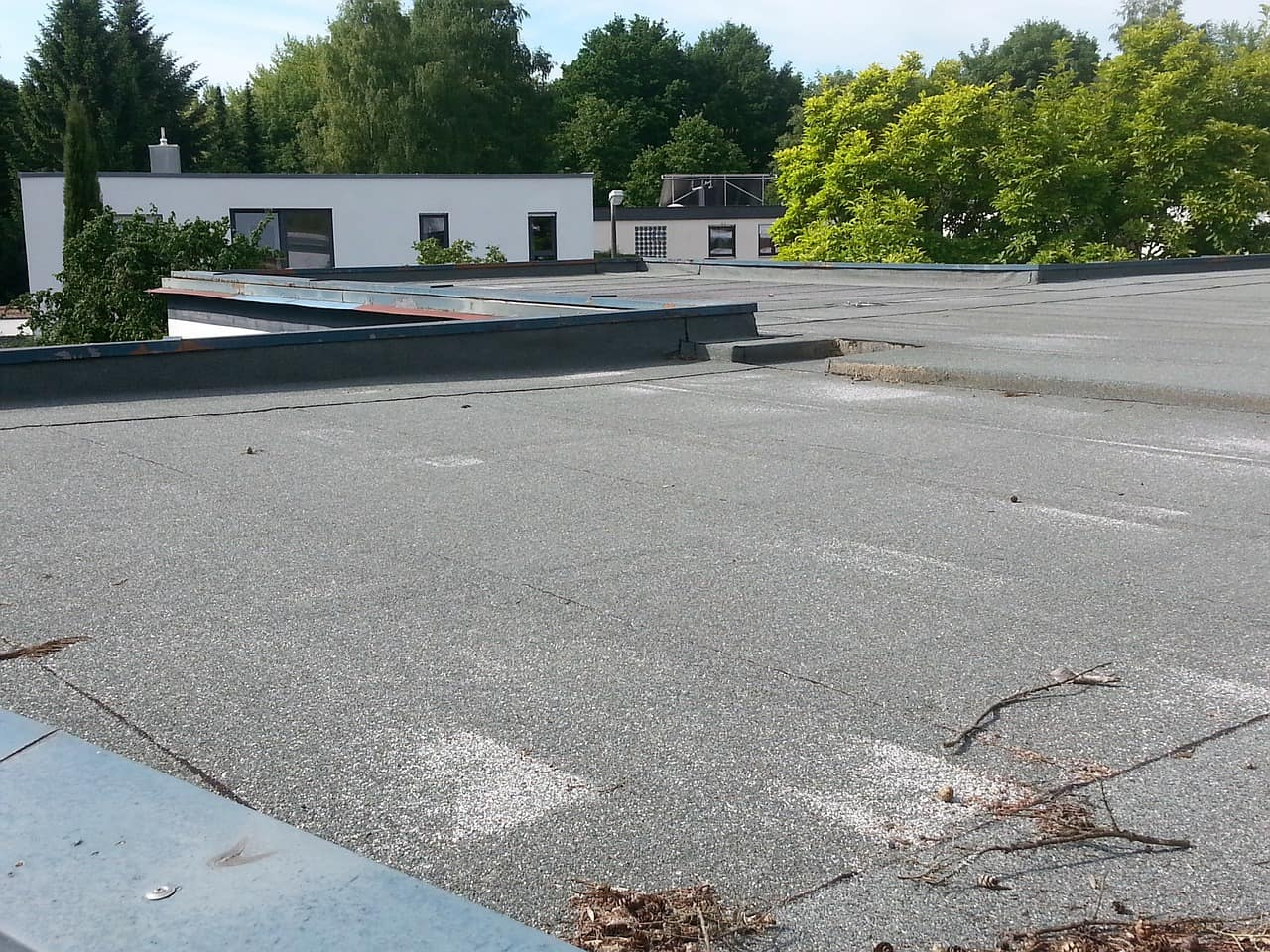 low spots on flat roofing